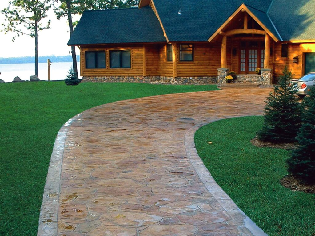 """Using decorative concrete as part the overall design of a home is also happening in the Staples, Minn., area. """"We have been doing large decorative driveways, 2,000 to 5,000 square feet, lakeside patios and wrap around porches,"""" says Mike Verlennich of Verlennich Masonry and Concrete."""