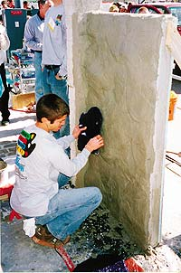 Flex-C-Ment Wall Mix is a cementitious wall product is being applied to a wall which will then be carved.