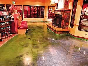 Polished concrete with concrete dye in green has been sealer using the correct concrete sealer for a busy market floor.