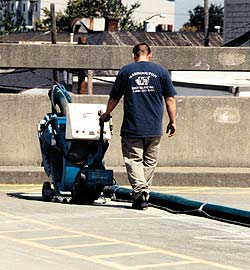 A shot blaster is the tool of choice for concrete contractors when prepping a surface.