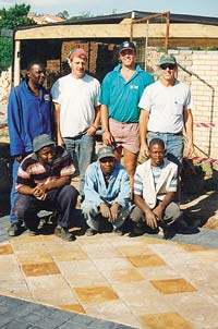 Mike Archambault (back row, far right) with students in Johannesburg, South Africa.