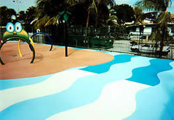The pool deck at disney world uses vibrant blues and contrasting whits to make a wave effect on this pool deck