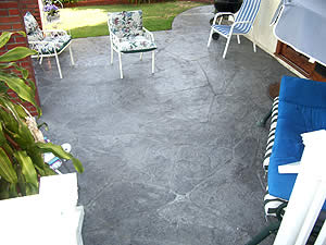 Restoring this pool deck meant more that just a touch-up. Colors and textures are used to take it up a notch.