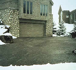 Using the radiant heat outside of a garage to avoid snow shoveling in the dead of winter.