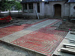 Adding radiant heat to home driveway helps with snowmelt as well as other benefits.