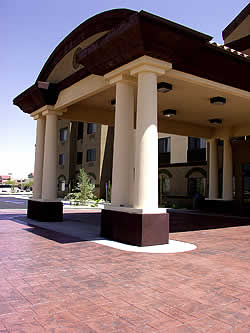 A large columned driveway is colored and stamped with Rafco products.