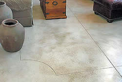 Simple concrete floor with joints engraved in a decorative pattern.