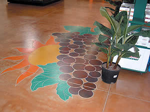 Stained concrete floor with a grape cluster and sunrise mural.