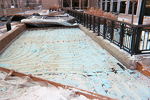 Rhodes Tower Project - Radiant heat tubing was placed beneath the sidewalks as a natural ice-melting system. The tubes sit upon half-inch sheets of extruded polystyrene foam, a lightweight material that the winter winds blowing off Lake Erie redistributed through the city.