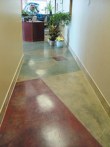 This concrete floor and the concrete countertop above were created with different shades of QC's Patina Stains.