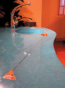Lokahi Stone - teal concrete countertop side bar with inset stone and metal with a integral sink.