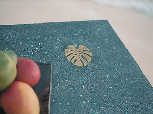 Lokahi Stone - Teal concrete countertop with inset brass leaf.