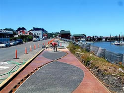 Bandon Boardwalk Construction - The concrete mix included a fiberglass mesh additive to improve its strength and allow workers to pull away texture mats without damaging the curing slab.