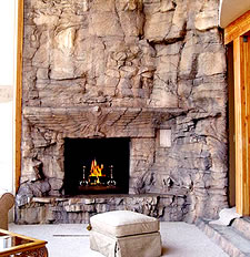 Concrete Fireplace - Stunning faux rock fireplace surround looks so realistic that you would never know it is concrete.