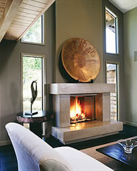 Concrete Fireplace -Fireplace surrounds can be made from the same mix used for countertops and other interior applications.