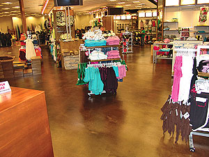 Seamless Floor Coatings in a retail setting in a rich brown color over concrete.