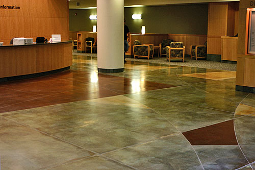 An acid stained Polished Concrete Floor can be more muted than using a dye to color the polished concrete.