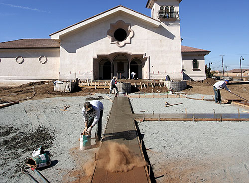 Carlton Concrete at the Holy Cross Catholic Church give the old build a new colored and stamped concrete walkway.