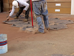 Tamping concrete Stamps with a tamper ensures a full stamp impression.