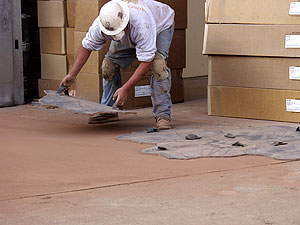 Placing concrete Stamp Pads next to each other to create a realistic stamping pattern on a concrete slab.