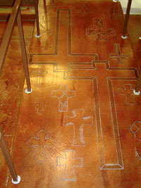 Floor Seasons - engraved crosses in an acid stained floor.