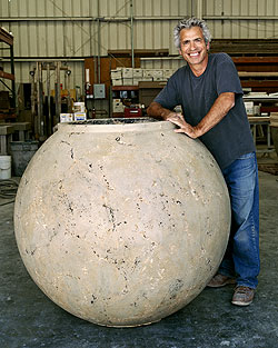 Buddy Rhodes stands next to a 48-inch concrete planter created with a mold from his new line.