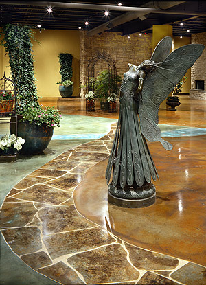 Acanthus Concrete Stain Designs - This floor design at Jacksons Home and Garden in Dallas, Texas, is made to look like a walk in a garden.