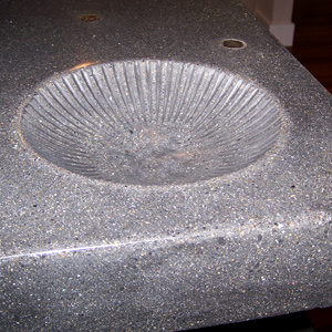 Using different imprints to create a shell like sink in concrete.