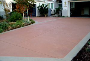 Restoring, refurbishing and coloring this concrete driveway gives the whole house a better look.