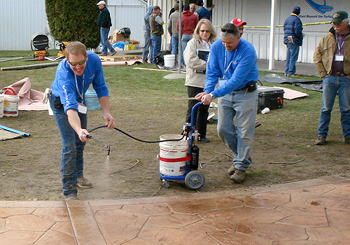 Dave Blasdel and Clark Branum apply color on a stamped concrete walkway
