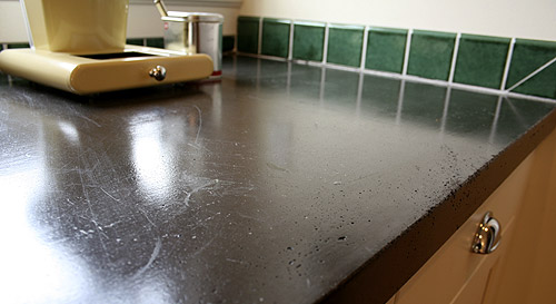 Quikrete Concrete Countertop Mix was used on this black kitchen countertop