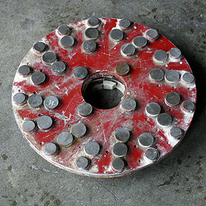 A custom metal leveling plate from the stone restoration industry.