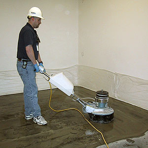 A man running a concrete polishing machine.