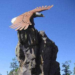 An eagle takes flight from a Synthetic Rock Features - Coloring synthetic rock is an artistic endeavor, with the panels in the place of the painter's canvas and a variety of tools for applying all kinds of media.
