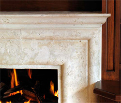 Concrete fireplace surround creates an elegant living room ambiance.