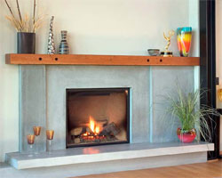 Modern fireplace surround and hearth with a wood mantle.
