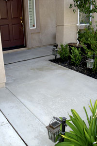 The front entry of this home had suffered differential curing caused by two separate pours.