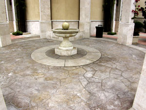 Concrete fountain made to look like an old rustic courtyard.