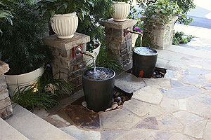Two water fountains side by side that create a serene feeling to all who visit.