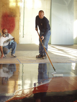 Bob Harris applying a sealer to a concrete floor.