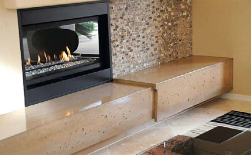 Fireplace: Eric Pottle, Surfaceworks AZ, Peoria, Ariz. Sand-colored floating hearth with toe kick