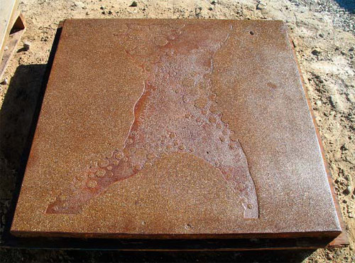 The portable mockup for a sandblasting job at a home in Truckee, Calif., was lightly diamond ground, stained and sealed. Notice how the raw embossed surface has been refined.