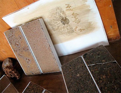 Portable samples of patina-stained, ground and polished concrete.