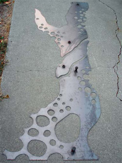 A steel template for sandblasting.