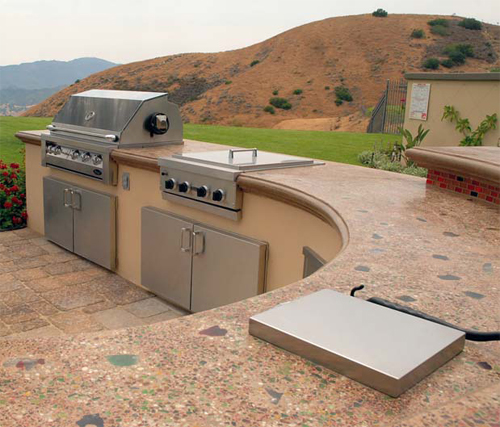 Concrete Countertop with a built in grill that overlooks a beautiful mountainscape.