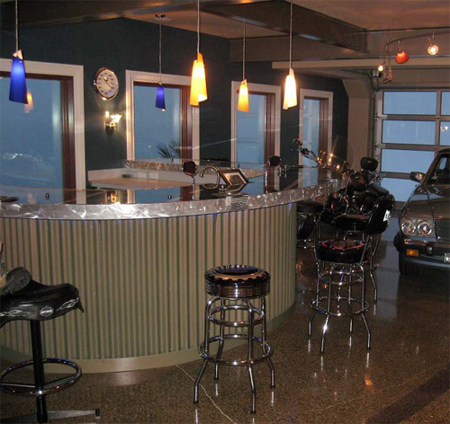 "Absolute ConcreteWorks LLC, of Poulsbo, Wash., garnered an Excellence in Concrete Construction Award in the residential decorative concrete category from the Washington Aggregates & Concrete Association for this custom-made GFRC bar. The bar, which is the focal point in what the homeowner has referred to as his ""man cave,"" features parts and pieces of a Harley motorcycle."